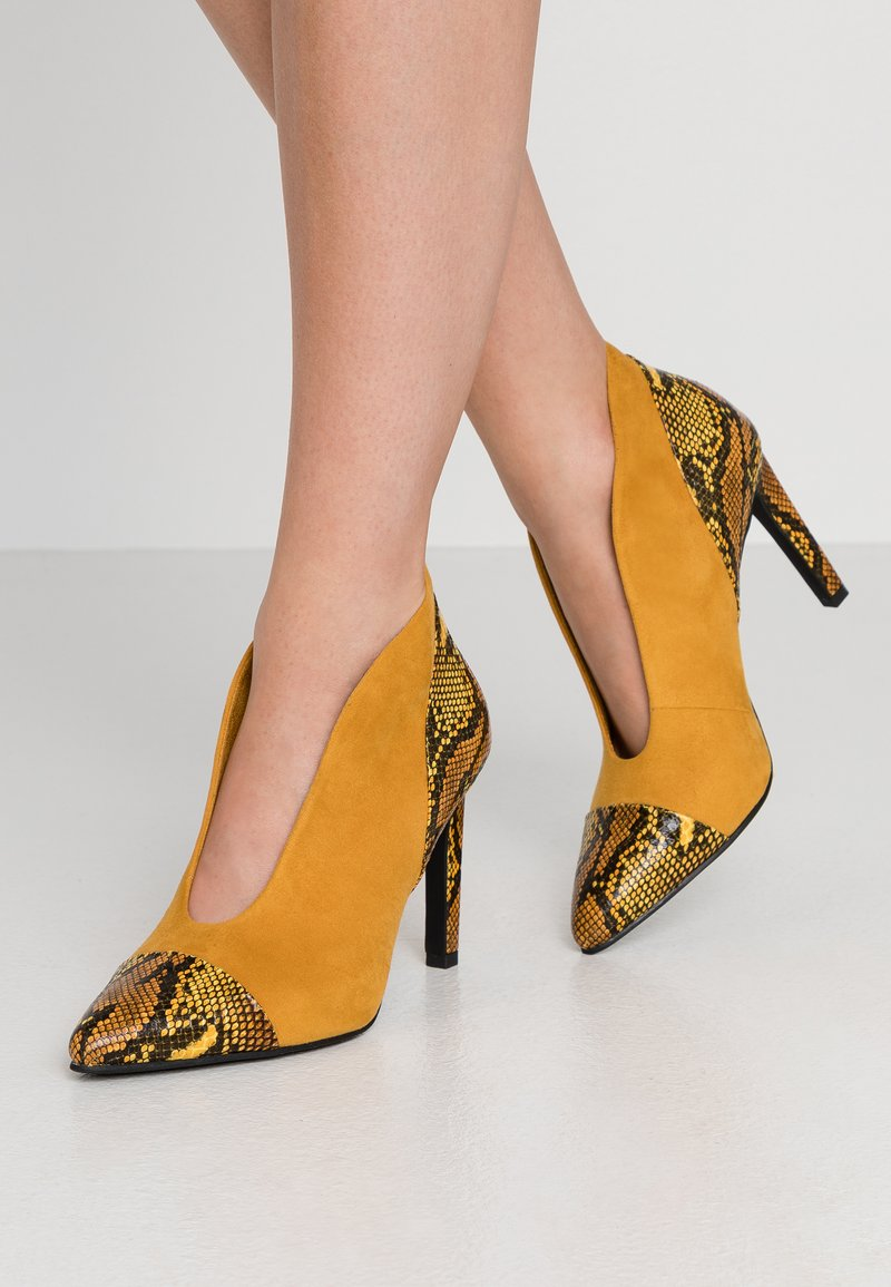 Marco Tozzi - High heeled ankle boots - saffron