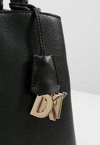 DKNY - MEDIUM SATCHEL - Handbag - black/gold - 6