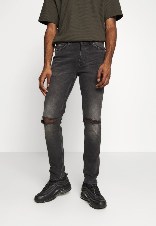 WASHED RIP FLAP - Jeans Skinny Fit - washed black