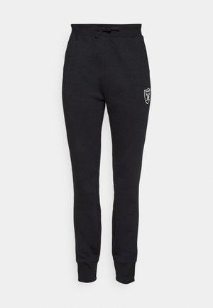 NFL LAS VEGAS RAIDERS MID ESSENTIALS ESSENTIALS JOG PANT - Teplákové kalhoty - black