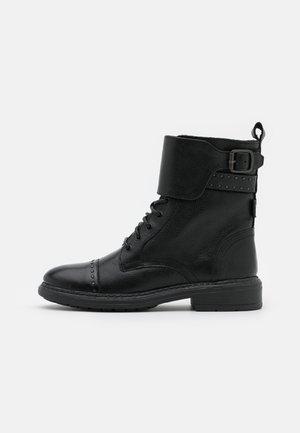 SLY STUDS - Cowboy/biker ankle boot - regular black
