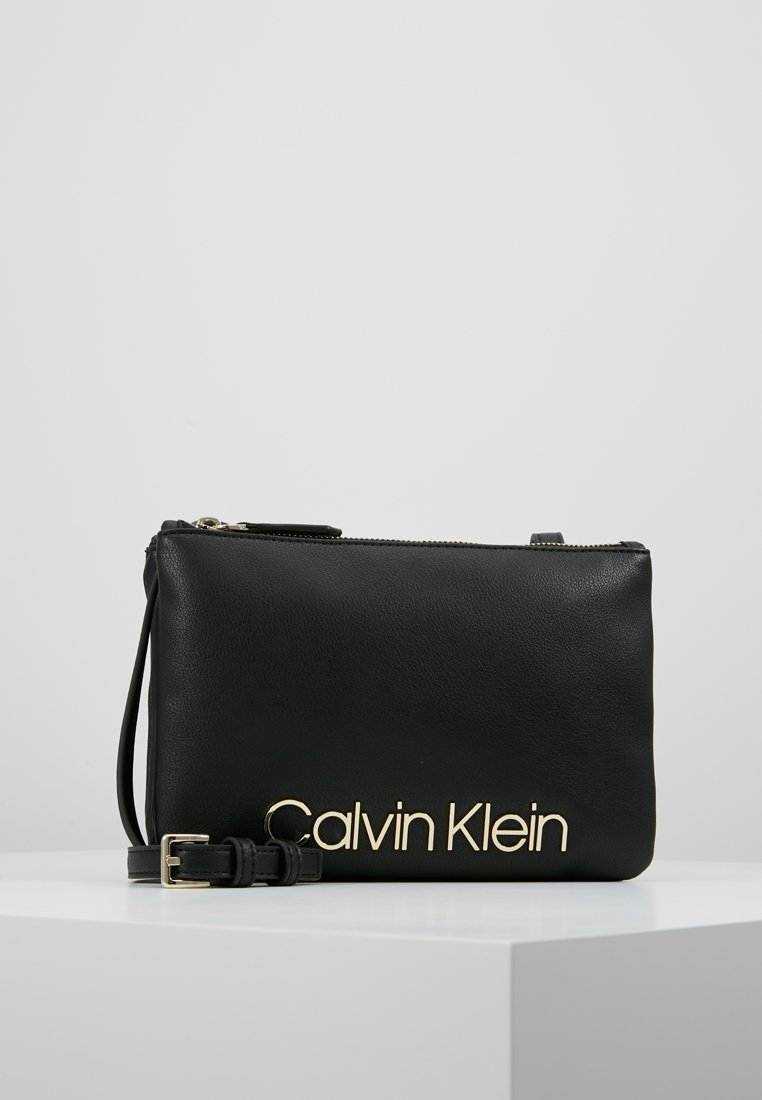 Calvin Klein - MUST CROSSOVER - Across body bag - black