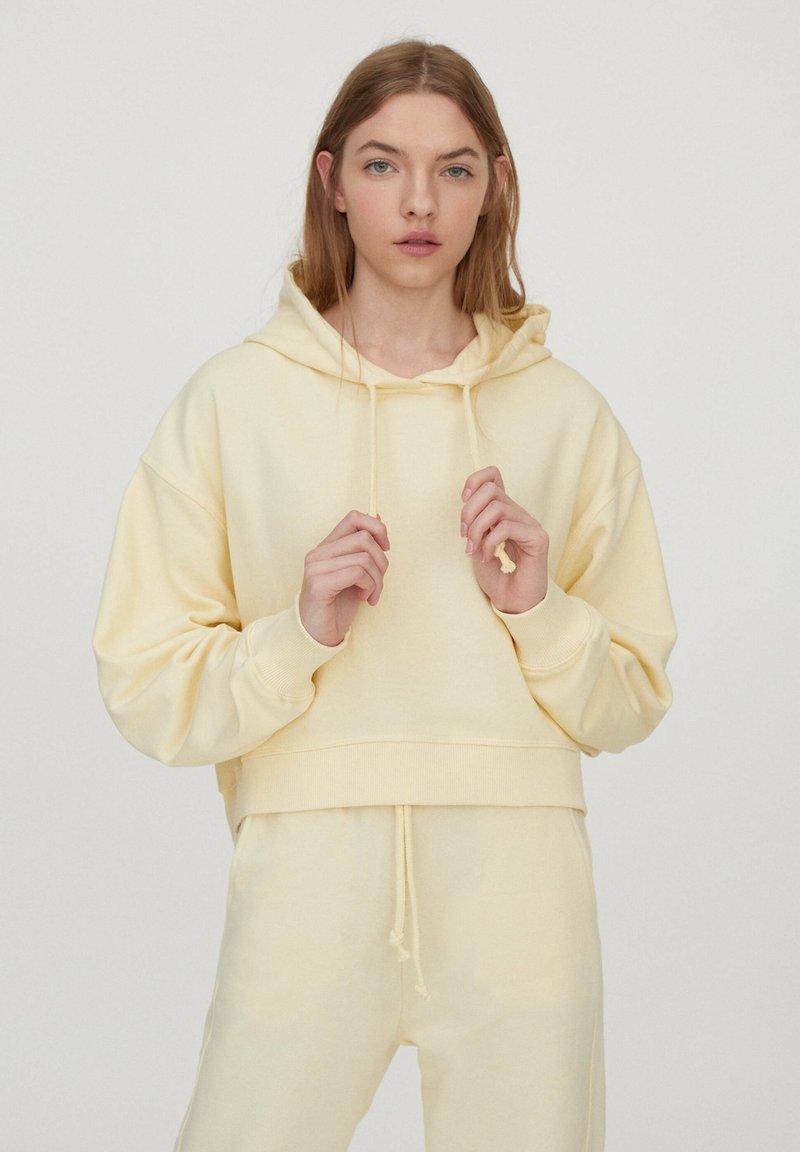 PULL&BEAR - Sweatshirt - mottled dark yellow