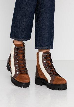 GROOVE - Platform ankle boots - cognac