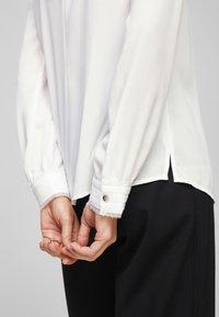 s.Oliver BLACK LABEL - MIT CHIFFON-BLENDE - Long sleeved top - cream - 4