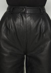Deadwood - PINE PANTS - Leather trousers - black - 6