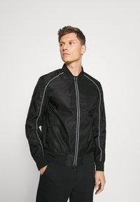 Armani Exchange - JACKET - Summer jacket - black - 0