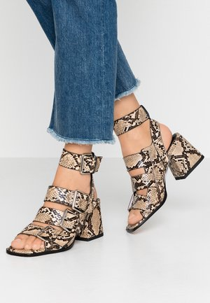 MULTI BUCKLE FLARED HEEL - Sandály - natural
