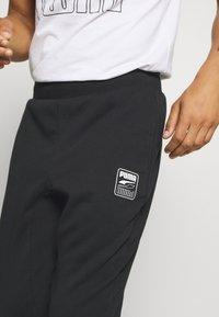 Puma - REBEL PANTS BLOCK - Tracksuit bottoms - black - 3