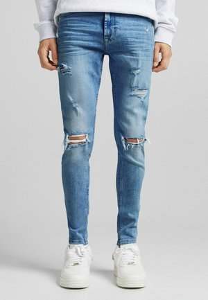 RIPPED - Slim fit jeans - blue