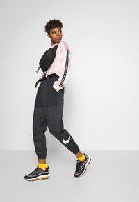 Nike Sportswear - PANT - Teplákové kalhoty - black/white - 1