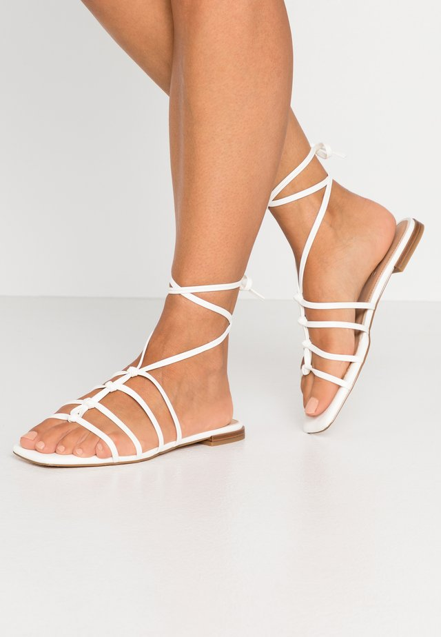 CROSSED STRAPS FLATS - Sandals - offwhite