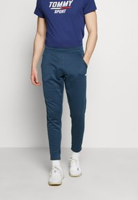 The North Face - MENS SURGENT CUFFED PANT - Teplákové kalhoty - blue wing teal heather - 0