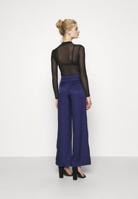 Never Fully Dressed - VOGUE - Trousers - blue - 2
