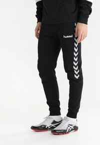 Hummel - AUTHENTIC CHARGE  - Tracksuit bottoms - black - 0