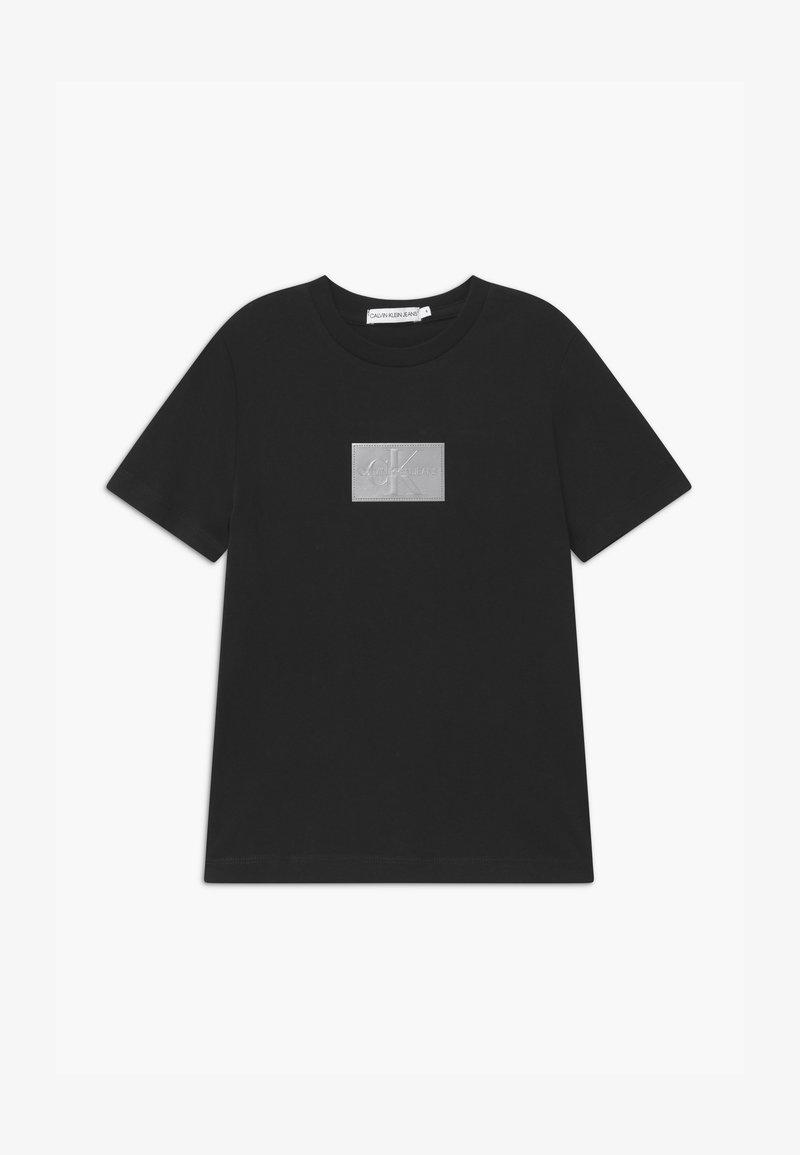 Calvin Klein Jeans - REFLECTIVE BADGE - T-shirt print - black