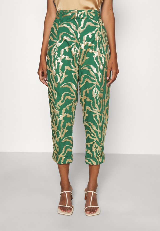 PLEAT FRONT TAPERED CUFFED ABSTRACT ANIMAL MOT - Trousers - green/gold