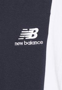 New Balance - ATHLETICS - Tracksuit bottoms - eclipse - 3