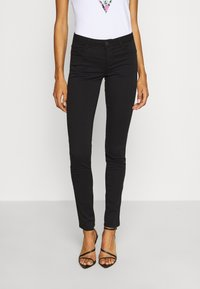 Guess - CURVE  - Trousers - jet black - 0