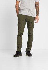 Columbia - DESCHUTES RIVER CARGO PANT - Trousers - peatmoss - 0