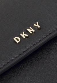 DKNY - WINONNA FLAP - Torba na ramię - black - 5