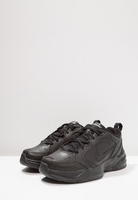 Nike Sportswear - AIR MONARCH IV - Trainers - black - 2