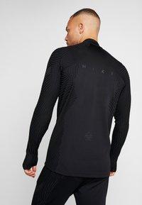 Nike Performance - DRIL - Camiseta de deporte - black - 2