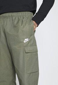 Nike Sportswear - Tracksuit bottoms - twilight marsh/white - 5