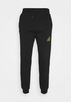 CANEYJOGGER - Tracksuit bottoms - black/gold