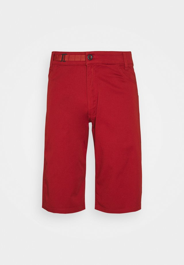 CREDO SHORTS - Sports shorts - red rock