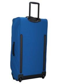 Eastpak - Wheeled suitcase - blue - 1