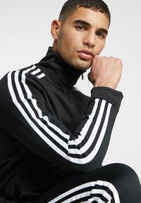 adidas Originals - BECKENBAUER UNISEX - Veste de survêtement - black - 3