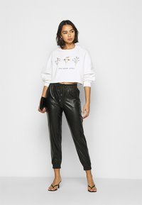 ONLY Petite - ONLMADY-CALLEE  - Trousers - black - 1