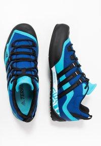 adidas Performance - TERREX SWIFT SOLO - Climbing shoes - royal blue/core black/signal cyan - 1