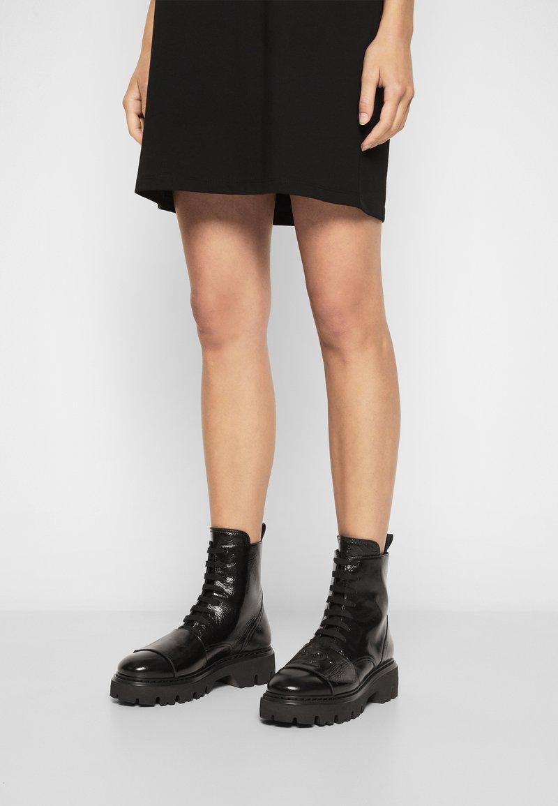 N°21 - BOOTS - Platform ankle boots - black