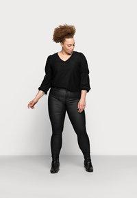 Pieces Curve - PCSHAPE UP PARO CURVE - Trousers - black - 1