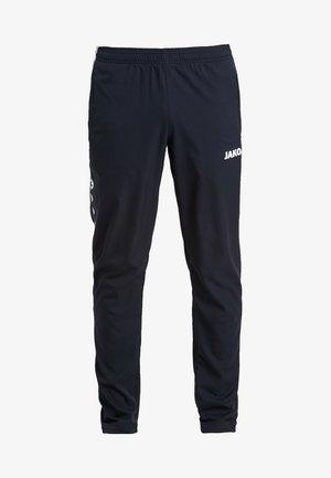 STRIKER - Pantalon de survêtement - schwarz/weiß