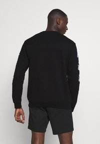 adidas Originals - GOOFY CREW - Sweatshirt - black - 2