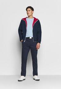 Calvin Klein Golf - RADICAL CHINO TROUSER - Chino kalhoty - dark navy - 1