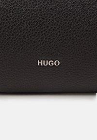HUGO - VICTORIA DRAWSTRING - Across body bag - black - 5