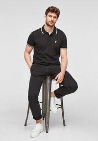 s.Oliver - Polo shirt - black - 6