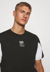 Puma - REBEL ADVANCED TEE - Print T-shirt - puma black - 3