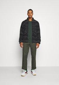 Reebok Classic - Summer jacket - black - 1