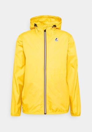 LE VRAI CLAUDE UNISEX - Waterproof jacket - yellow