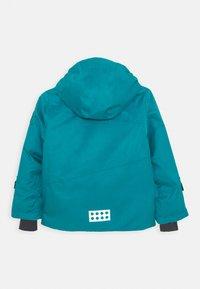 LEGO Wear - JOSHUA 700 JACKET UNISEX - Snowboardová bunda - dark turquoise - 1