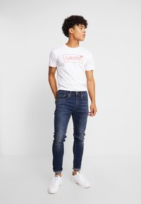 Levi's® - 519™ SKINNY BALL - Jeansy Skinny Fit - can can - 1
