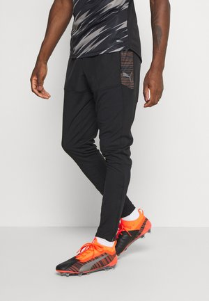 PRO PANT - Pantalon de survêtement - black/shocking orange