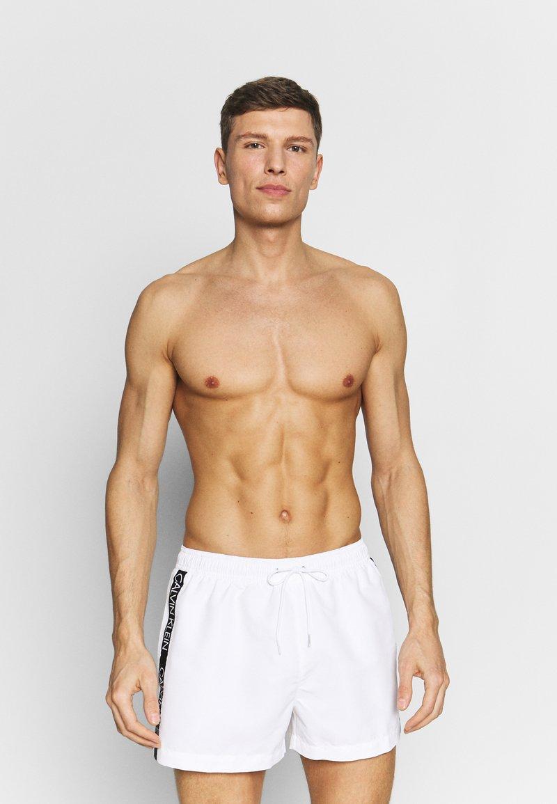 Calvin Klein Swimwear - DRAWSTRING - Plavky - white