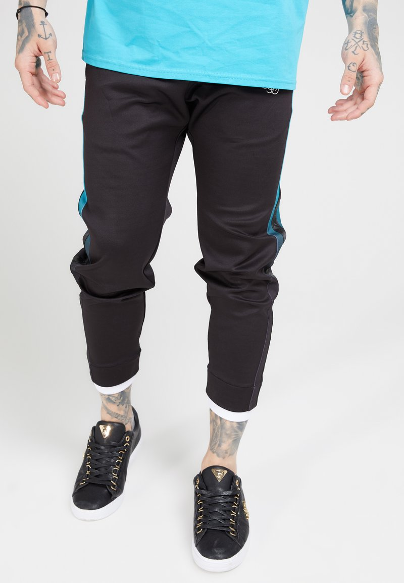 SIKSILK - FITTED TAPE TRACK PANTS - Tracksuit bottoms - black/teal