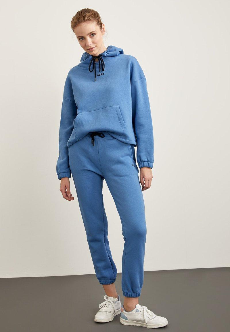 DeFacto Fit - Tracksuit bottoms - blue
